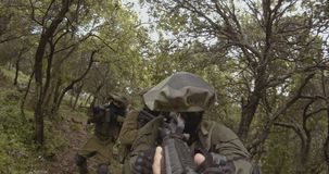 Weapon GoPro POV footage of a squad of Israeli commando soldiers during combat. Weapon POV footage of an Israeli army soldier squad during combat stock video footage