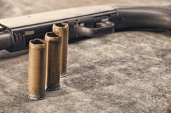 Weapon. Shotgun concept. Black shotgun and shotgun sleeve. Royalty Free Stock Photography