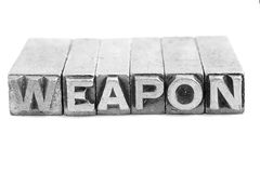 WEAPON sign, antique metal letter type Royalty Free Stock Photos