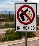 "Weapon signpost on the US-Mexican border. ""No weapons in Mexico"", US citizens learn as they cross into the Central American country at the US-Mexican border in Royalty Free Stock Image"