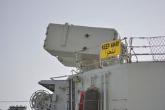 Weapon system on military ship. Weapon system on military ship with sigh Keep out Royalty Free Stock Photography