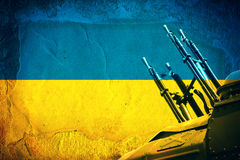 Weapon on Ukrainian Flag Stock Photos