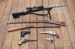 Weapons. Close up of a Collection of weapons rifles and pistols scoped and open sight stock photos