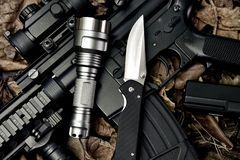 Free Weapons And Military Equipment For Army, Guns Tactical Flash Light And Pocket Army Knife. Stock Photo - 149496990