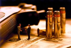 Weapons business. Bullets weapons business miniature concept Royalty Free Stock Photos