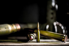 Weapons, cartridge on wooden background. Place for text Royalty Free Stock Photography