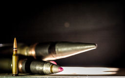 Weapons, cartridge on wooden background. Place for text Royalty Free Stock Image