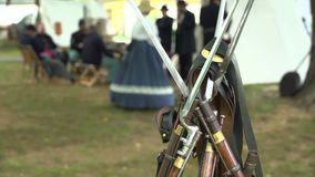 Weapons of Civil War soldiers leaning together. A shot of Weapons of Civil War soldiers leaning together stock footage