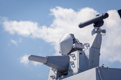 Weapons on the deck of a military ship. Weapon system for defense. Modern weapons on the deck of a military ship. Weapon system for defense Stock Photo