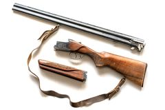 Weapons in a disassembled state. 12 gauge over under shotgun iso royalty free stock photo