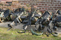Weapons on the ground. Automatic weapons lying against a wall during a training of the army Stock Photography