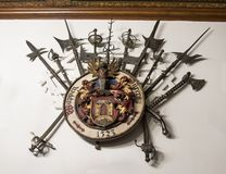 Weapons hanging on the wall in the inner room of the Peles castle in Sinaia, in Romania Royalty Free Stock Photography