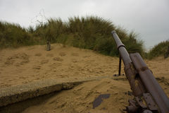 Weapons. Rifle on the beach of normandy Stock Photos