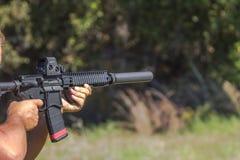 Weapons, Silencer, Bumpstock, Machinegun. Shooting weapons at the gun range,  Silencer, Bumpstock, Machinegun Royalty Free Stock Image