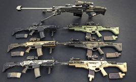 Weapons stash with automatic assault rifles and sniper rifle. Royalty Free Stock Photos
