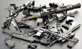 Free Weapons Stash Of Military Grade Weapons With Automatic Assault Rifles, RPG And Accessories. Royalty Free Stock Images - 179352289