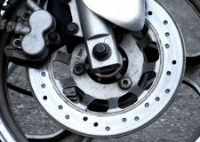 Wear brake disc on the front wheel of motorcycle Royalty Free Stock Images