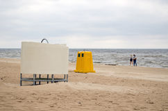Wear change cabin waste bin sea beach people Royalty Free Stock Photo
