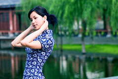 Wear a cheongsam Oriental woman Stock Photography