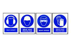 Wear earmuffs or earplugs, Wear head protection, Wear goggles,Wear hand protection, Blue and white Safety signs Royalty Free Stock Images