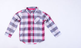 wear för barn s Barns kläder på bakgrund wear för barn s Arkivfoto