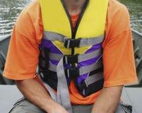 Wear a life jacket. Man wearing a life jacket Royalty Free Stock Photos