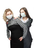 Wear mask against viruses. Girls in medical masks standing together against viruses isolated over white background Royalty Free Stock Photo
