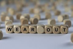 Wear out - cube with letters, sign with wooden cubes Stock Image