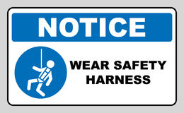Wear safety harness sign. Information mandatory symbol in blue circle isolated on white. Vector illustration. Notice label stock illustration