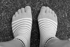 Wear socks five fingers style on Black and White Royalty Free Stock Image