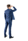 Wear view of businessman looking away Stock Images