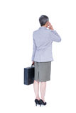 Wear view of businesswoman stranding with suitcase Stock Photo