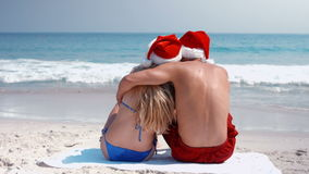 Wear view of couple hugging with santa hat