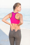Wear view of fit woman looking at the sea with hands on back Royalty Free Stock Photography