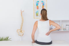 Wear view of patient with back pain. In medical office Royalty Free Stock Photos