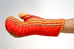 Weared oven glove Stock Images