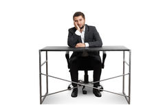 Wearied businessman sitting Royalty Free Stock Photos