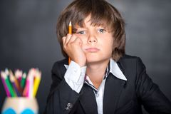 Weariful school boy dreaming while lesson Stock Images