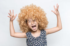 Wearing a blonde wig and funny facial expression Asian girl Royalty Free Stock Image