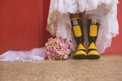 Wearing boots and bridal dress