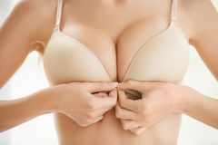 Wearing bra. Close-up of women wearing bra Royalty Free Stock Image