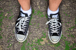 Wearing casual shoes. Looking down wearing casual shoes Royalty Free Stock Photography