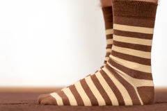 Wearing comfortable striped socks Stock Photo