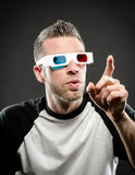Wearing 3d glasses and pointing Royalty Free Stock Image