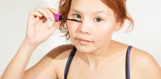 Wearing eyes mascara Stock Photo