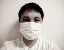 Wearing face mask. Man wearing face mask sick mask nose Stock Image