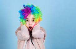 Wearing the foolish clown face. Surprised small clown with opened mouth. Adorable little girl wearing brightly colored royalty free stock photography
