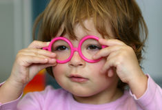 Wearing glasses. Little kid wearing toy glasses Royalty Free Stock Photo