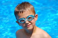 Wearing Goggles. Boy in swimming pool with goggles Stock Images