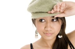 Wearing Hat. A pretty young woman in a funky green hat Stock Photo